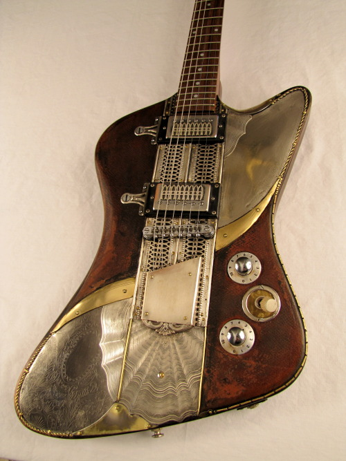 "Sandpiper Electric Guitar -  by Tony Cochran Guitars Monaco ""Stallion"" Ceriani worked his magic with this electric guitar at the now shuttered Sandpiper Motel and Lounge in Bolivia, NC. His music was a peculiar mix of P-Funk and Psychedelic Jazz with a weird Reggae flavor that left everyone confused about how to dance to it. It is rumored he built the guitar from the broken shell of a 1965 Firebird, an old Epiphone, and his dead Mom's jewelry box. The Lounge was closed in 1975 when US 17 caused a decline in attendance. The Stallion decided to sell the guitar and switch to screenwriting. He was contributor to many Different Strokes episodes, as well as being a musical consultant to The Partridge Family. - See more at: http://www.tonycochranguitars.com/sandpiper.html"