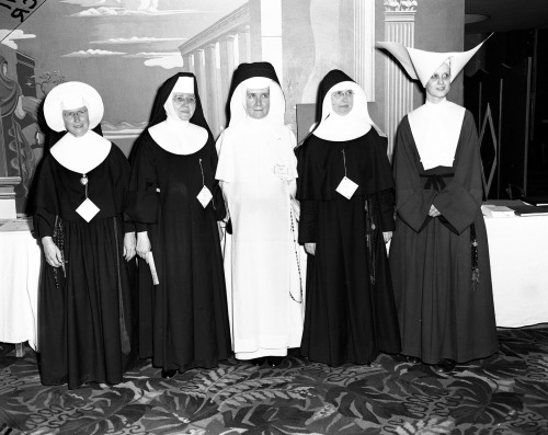 …  a delightful array of habits Nuns of various orders at a conference related to the Second Vatican Council, Hotel Lobby, Chicago, c1960s. Featuring from left to right: a Sister of the Holy Cross, a Franciscan Nun, a Dominican Nun, a Sister of St. Agnes, and a Daughter of Charity.