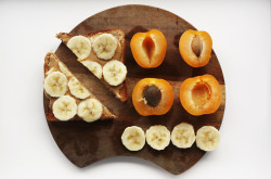 dailyoats:  Study break - time for a snack. Wholegrain toast with homemade peanut butter and half a banana and two apricots.