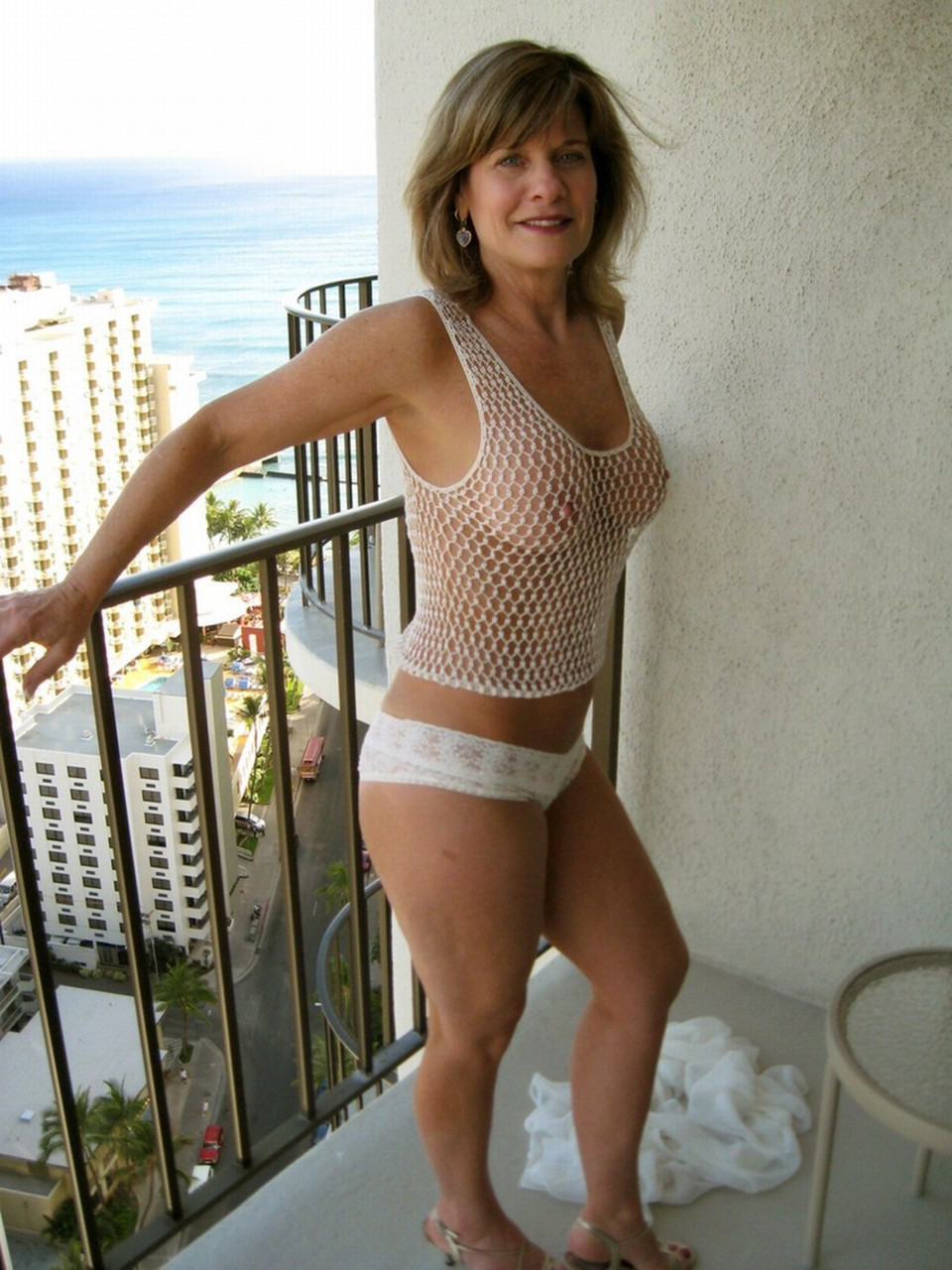 Mature woman see through top