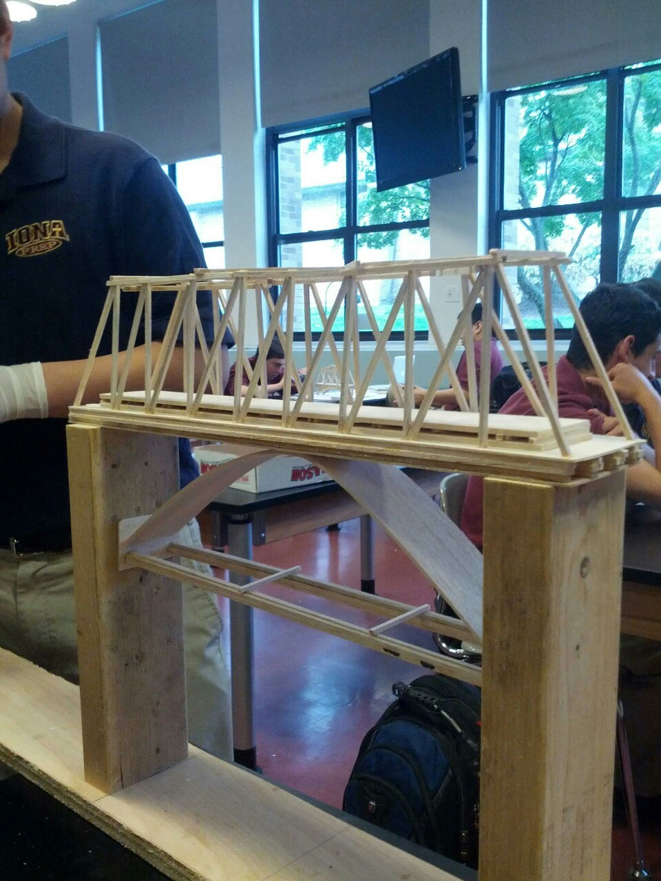 Day 7 Physics Bridge Project Today we finished the bottom part of the truss as evidenced by the picture above. Tomorrow are prsentations and on Monday we will reinforce the bottom.