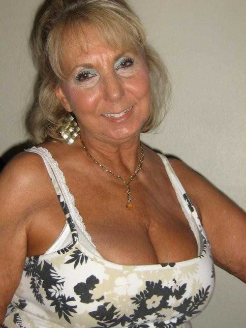 Mature women down blouse cleavage