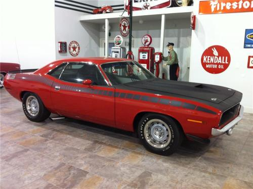 1970 Plymouth AAR Cuda  All had 340 cu.in. with special blocks and heads. And were equipped with  3 2-barrel Holley carbs. It also had side discharge exhaust system,  the tail pipes dumped just forward of the rear tires. The inlet and exit of the mufflers were both on the forward end of the muffler.