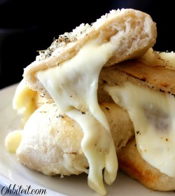 weeheartfood:  Cheesy Biscuit Bombs: 1 Container of Pillsbury Grands Flaky Layers Biscuits, 3/4 lb Mozzarella, 1/4 cup Olive Oil, 1/4 cup Grated Parmesan, 1 tsp. Oregano/Italian Seasoning; Bake 350 for 15-20 minutes