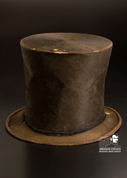"Abraham Lincoln's Stovepipe Hat Nothing brings the image of Abraham Lincoln to mind better than his iconic stovepipe hat. And nothing sums up Lincoln's beliefs better than a scrap of paper he may have stored in that battered hat. ""As I would not be a slave, so I would not be a master. This expresses my idea of democracy,"" the piece of paper says. Now, just in time for Lincoln's birthday, both the hat and the note on democracy are going on display at the Abraham Lincoln Presidential Library and Museum. They'll be added to the museum's Treasures Gallery on Wednesday, Jan. 23, and remain on display about six months. The beaver-fur hat has two bare patches on its brim where Lincoln's fingers wore it out as he continually doffed it to passersby. As he traveled from courthouse to courthouse on the Illinois prairie, Lincoln needed to stay warm and protect his legal papers. ""Solving both problems, Lincoln kept his head warm and dry under this beaver-fur stovepipe hat, and he tucked his letters inside the hatband. It was his 'office in his hat,' according to a fellow attorney, and everyone on the circuit knew this amusing characteristic of Lincoln,"" said ALPLM Lincoln Curator James Cornelius.  To hear more about Abraham Lincoln's hat, listen to our latest podcast."