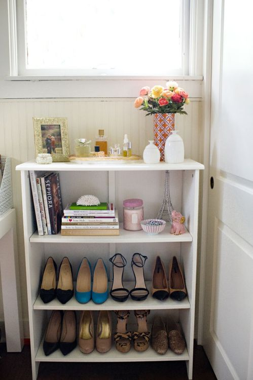 theeverygirl:  a girl can never have too many shoes  new apartment ideas.   half of the reason i bought peaches and apples today was because they were $1 and the glass jar they've come in is so cute. i can't wait to repurpose them.
