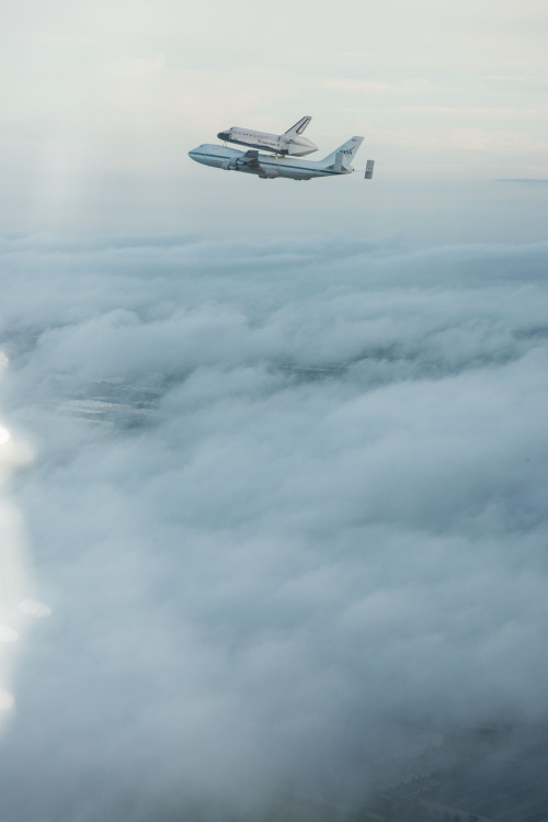 spaceplasma:  Above the Clouds Space Shuttle Endeavour being ferried by NASA's Shuttle Carrier Aircraft as it departs KSC. NASA pilots Jeff Moultrie and Bill Rieke are at the controls of the Shuttle Carrier Aircraft. Photo taken by NASA photographer Robert Markowitz in the backseat of a NASA T-38 chase plane with NASA pilot Greg C. Johnson at the controls. Photo Date: September 19, 2012. Location: Kennedy Space Center, Florida. Photographer: Robert Markowitz Source: NASA - Flickr
