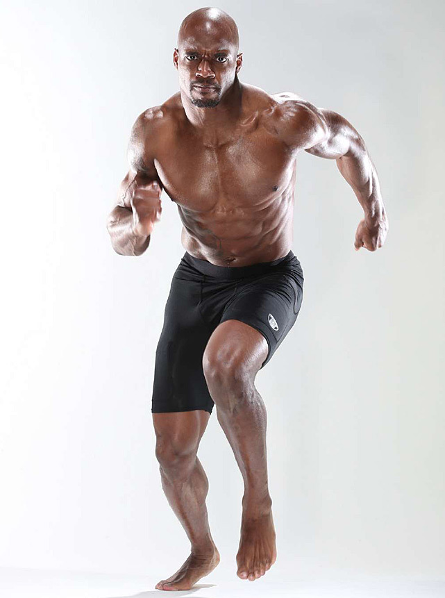 Adrian Peterson shows off his running form during a Dec. 2012 SI photo shoot. (Simon Bruty/SI) GALLERY: Rare Photos of Adrian Peterson