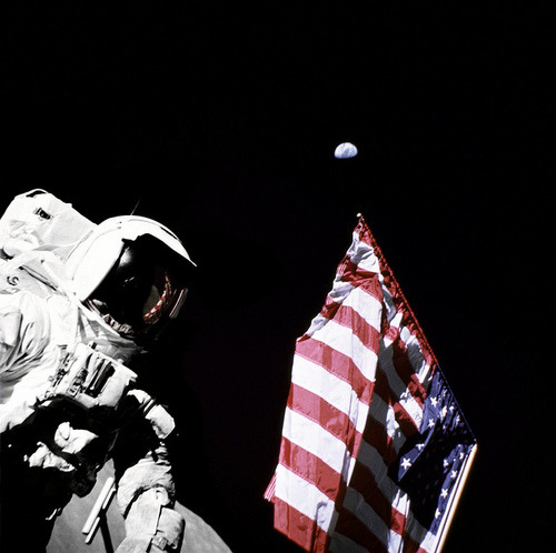 Schmitt with Flag and Earth Above by NASA Goddard Photo and Video on Flickr.Via Flickr: Geologist-Astronaut Harrison Schmitt, Apollo 17 Lunar Module pilot, is photographed next to the American Flag during extravehicular activity (EVA) of NASA's final lunar landing mission in the Apollo series. The photo was taken at the Taurus-Littrow landing site. The highest part of the flag appears to point toward our planet earth in the distant background. NASA Identifier: GPN-2000-001137