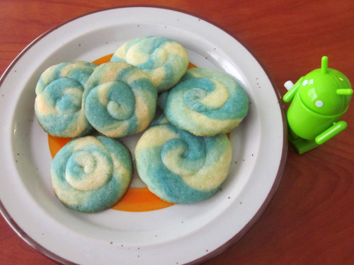 Pinwheel Swirl Sugar Cookies Ingredients: · 1 pouch Betty Crocker sugar cookie mix · 1 stick of butter · 1 egg · Food coloring Instructions: 1. Mix the sugar cookie dough according to the directions. 2. Divide dough into parts, and dye with food coloring as desired. 3. Chill cookies in the fridge for at least half an hour. 4. Make a grape-sized ball out of each color dough, then quickly roll them all into a larger ball. 5. Place each large ball back in fridge when finished. 6. Prepare cutting board with flour, or cover with wax paper. 7. Roll out each large ball into a log. 8. Twist the log into stripes by rolling the two ends in opposite directions on the cutting board. 9. Coil into a spiral cookie and place back in fridge. 10. Bake on greased sheet at 350 F for 7 minutes. Tips: · Try to underbake so it doesn't get too golden. · The dough was really soft and sticky after mixing, so the refrigeration is necessary! · When I made the spirals, I rolled the dough into large logs and smushed them together (I listed another method in the instructions above, hopefully it works better). They blurred though, since they were really sticky. · Perhaps try with a homemade dough, for a different consistency? · The dough when warm can break very easily. Keep them in fridge whenever not immediately working on them. Roll on board with log pointing towards you, and move palm over it left to right with little applied force. · Watch out for necking, and cut log if it's getting too long. · The thinner the log, the prettier the final cookie will look though.