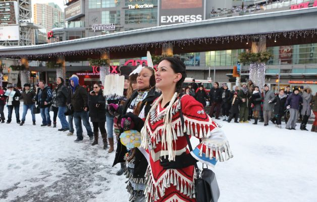 Idle No More round dance at Yonge-Dundas Square New Year's Day. Photo By Cheol Joon Baek  Idle No More began with 4 ladies; Nina Wilson, Sylvia McAdam, Jessica Gordon & Sheelah McLean who felt it was urgent to act on current and upcoming legislation that not only affects our First Nations people but the rest of Canada's citizens, lands and waters.