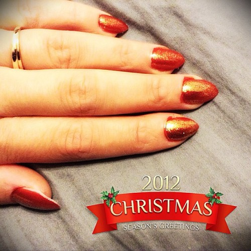 "Holiday stiletto nails. Used OPI nail polishes (James Bond collection). Colors are ""Die Another Day"" and ""Goldeneye"". #opi #nails #holiday #red #christmas #gold #redlotusdesignz"