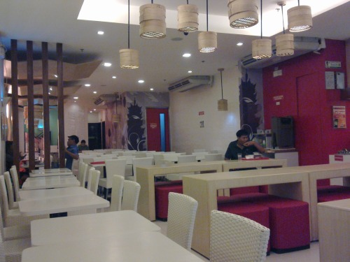 Dimsum Break Place: Classy enough.  Nice modern furnishings and color combinations.  We loved the steamer lights!  Some tables were a little wobbly though.  And the floor near the restroom was dirty. Food: Generally O-K, puwede na.  We ordered Garlic Pork Spareribs, Spring Rolls, Fried Wanton, Fried Shrimp Balls, Shaomai, Steamed Hakao, Yang Chow Fried Rice, and The Original Steamed Fried Rice. The Garlic Pork Spareribs (Php 65) were good.  The meat was tender and well seasoned.  The garlic flavor wasn't too strong, making the dish a delight to eat. The Spring Rolls (Php 65) were O-K.  The filling was meaty, and tasty enough.  The thing is, we've tasted much better spring rolls than Dimsum Break's.  Maybe some minced vegetables with the filling would've made these rolls more remarkable to the palate. The Fried Wanton (Php 65) was also O-K.  The filling was like a slightly more pungent version of a siomai's; it wasn't bad, but it wasn't great.  Now the wrapper: it's cute too look at, but a little too much to eat; it was a tad too thick and too floury to the palate.  The Fried Shrimp Balls (Php 65) were, hmmm, interesting.  They were crunchy (because of the bread-pieces coating, kinda like croutons), well seasoned, and yummy.  But we barely sensed any shrimp flavor.  The balls tasted more like pork.  Weird right?  Oh well… The Shaomai (Php 65) was not good.  The filling didn't taste fresh, lasang luma. The Steamed Hakao (Php 65) was DELICIOUS.  The filling was firm and flavorful.  The wrapper though tended to break easily, but we didn't care that much, because the dish was just yummy! The Yang Chow Fried Rice (Php 68) was not good!  The shrimp flavor was too strong, and the dish lacked the distinct meat flavor (from chorizo) that good yang chow rice has.  Disappointing because the rice itself was of good quality. Lastly, the Steamed Fried Rice (Php 68): rice smothered with a brown (soy-sauce-based?) sauce, topped with shrimp and meat pieces.  YUMMY!  The flavors were punctuated, and each spoonful was satisfying. Must-eats: Steamed Hakao, Steamed Fried Rice Price: Considering serving size and taste, food here is cheap! Service: Good.  The cashier and waiters were friendly, cheerful, and attentive.