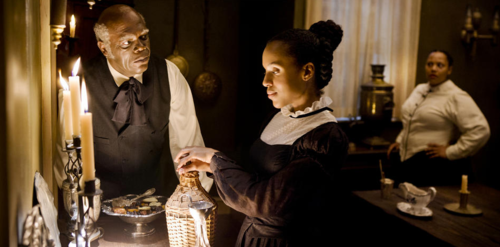 """What you whistlin', girl?"" Samuel L. Jackson as Stephen and Kerry Washington as Broomhilda in DJANGO UNCHAINED"