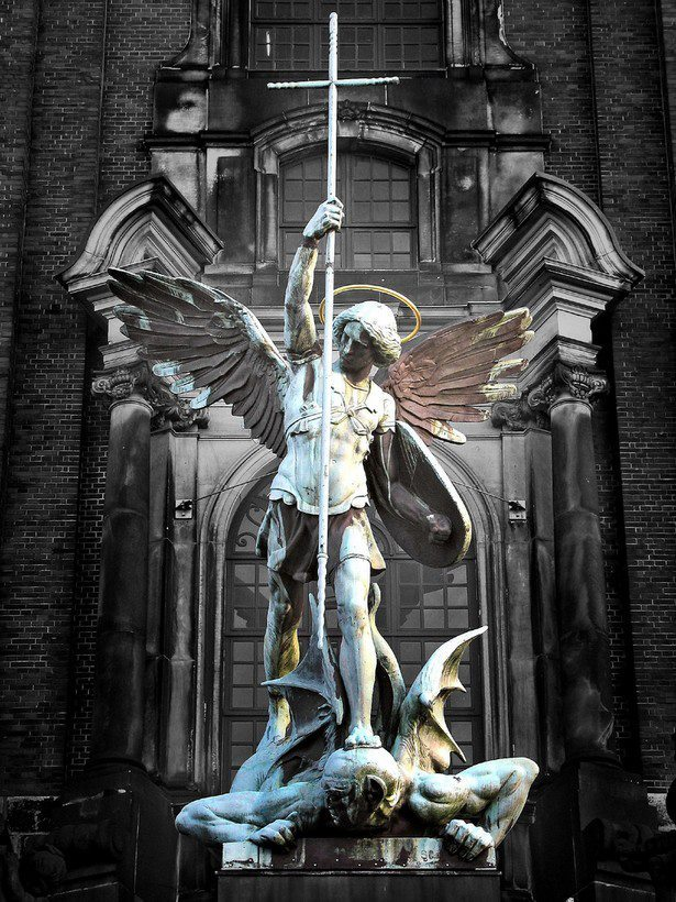 winningthebattleloosingthewar:  Archangel Michael's victory over the Devil, sculpture above the main entrance at St. Michaelis Church, Hamburg