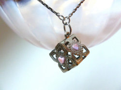 sogeekchic:  Companion cube inspired necklace ($24.50) available from FantastiquePlastique