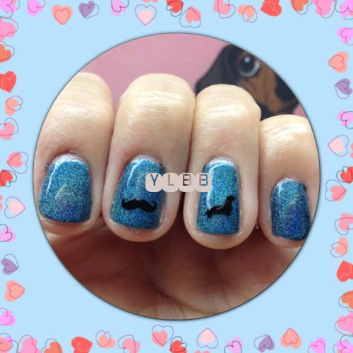 Wearing dachshund and mustache nail sticker decals.