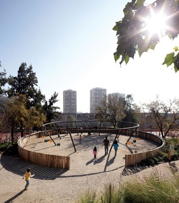 publicdesignfestival:  Located in the commune of Recoleta (Chile), the Children's Bicentenary Park by Elemental is a wide public space, which answers to the social need of green areas and is tailored to its little users, with wooden slides, tree houses, water playscapes and the former grillwork turned into a red labyrinth.