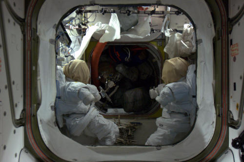 Two spacesuits locked in an eternal staring contest, ready to take us outside if needed.