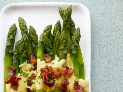 Asparagus with Bacon Sabayon Ingredients: Bunch of Asparagus Chives 4 Chopped Bacon Strips (Reserve 1 Tablespoon of Drippings) 4 Egg Yolks 3 Tablespoons Water 1 Tablespoon White Wine Vinegar 1 Teaspoon Dijon Mustard Pinch of Cayenne Directions: Cook the bacon strips until crisp. Drain on paper towels, reserving the drippings. Combine the egg yolks, water, white wine vinegar, dijon mustard and cayenne in a heatproof bowl set over simmering water; whisk until thick, 4 minutes. Remove from the heat and whisk in the bacon drippings, and salt to taste. Serve over steamed asparagus and top with chives and the bacon.
