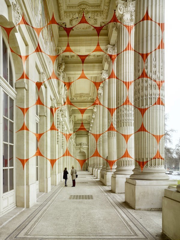 Swiss artist Felice Varini is know for his large scale projections of geometric forms onto rooms and exterior spaces. His latest work at the Grand Palais in Paris went up just last month, you can watch the video above to see how he works with projectors and stencils to create his artwork that only appears proportional when seen from a specific viewpoint. You can also follow him on Facebook.