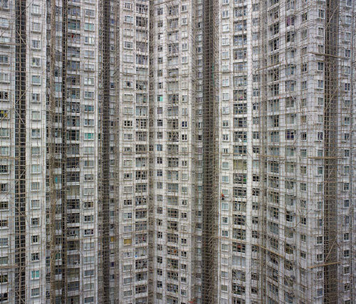 harpollo:  ridingwithstrangers:  Architectural Density in Hong Kong With seven million people, Hong Kong is the 4th most densely populated places in the world. However, plain numbers never tell the full story. In his 'Architecture of Density' photo series, German photographer Michael Wolf explores the jaw-dropping urban landscapes of Hong Kong. He rids his photographs of any context, removing any sky or horizon line from the frame and flattening the space until it becomes a relentless abstraction of urban expansion, with no escape for the viewer's eye. Infinite and haunting. Editor's Note: Co-signed.  incredible
