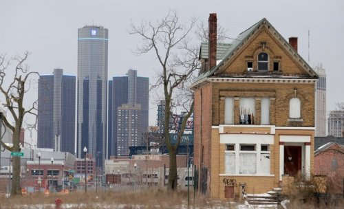 "The New York Times: ""A Private Boom Amid Detroit's Public Blight DETROIT — Private industry is blooming here, even as the city's finances have descended into wreckage. In late 2011, Rachel Lutz opened a clothing shop, the Peacock Room, which proved so successful that she opened another one, Emerald, last fall. Shel Kimen, who had worked in advertising in New York, is negotiating to build a boutique hotel and community space. Big companies like Blue Cross Blue Shield have moved thousands of workers into downtown Detroit in recent years. A Whole Foods grocery, this city's first, is scheduled to open in June. On Friday, just as Michigan's governor, Rick Snyder, was deeming an outside, emergency manager a necessity to save Detroit's municipal finances, the once-teetering Big Three automakers were reporting growing sales. ""It's almost a tale of two cities here,"" said Ms. Lutz, who is 32. ""I tripled my projections in my first year."" Around the country, as businesses have recovered, the public sector has in many cases struggled and shrunk. Detroit may be the most extreme example of a city's dual fates, public and private, diverging. At times, the widening divide has been awkward, even tense. As private investors contemplated opening coffee bean roasters, urban gardening suppliers and fish farms, Detroit firefighters complained about shortages of equipment, suitable boots and even a dearth of toilet paper."" Photo: J.D. Pooley/Getty Images"