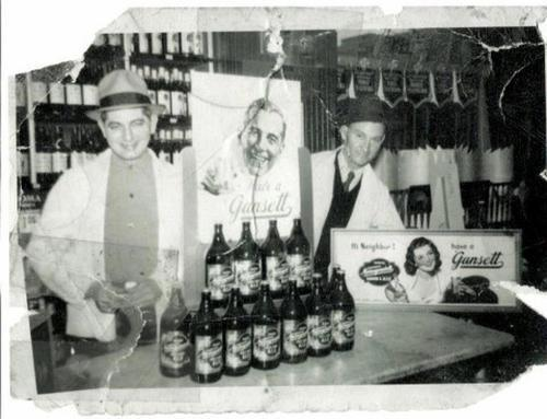 Hi Neighbor, Have a 'Gansett GIQ! John Simpson's Dad and Bill Carroll behind the counter at Benk's Liquor store in South Boston. Early 1940's.