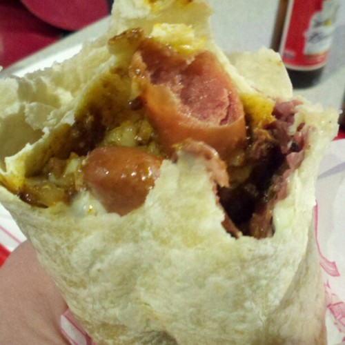 At @pinkslasvegas, one of the biggest items is the pastrami burrito: 2 hot dogs, pastrami, chili, cheese, and onions rolled up in a tortilla. I had to have one for the sake of research. #food #travel #vegas.