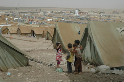 Photo: The Domeez refugee camp in Iraq, where MSF has been treating Syrian refugees since this past May. Iraq 2012 © Fayçal Touiz/MSF Humanitarian Response Still Insufficient For Syrians In and Out of the Country The humanitarian situation in Syria continues to worsen as the war escalates and attacks against health facilities continue. Access to large parts of the country remains extremely difficult due to insecurity and heavy fighting, and more than two million people have been displaced. The number of Syrians seeking refuge in neighboring countries is increasing, but the humanitarian response in Lebanon and Iraq has so far been unable to meet their needs. The arrival of winter is exacerbating the difficult living conditions of Syrian refugees and the population remaining in the country Doctors Without Borders/Médecins Sans Frontières (MSF) currently works in three field hospitals in the north of Syria. Since June, 10,000 patients have received medical attention for reasons including violence-related injuries such as gunshot wounds, shrapnel wounds, open fractures, and injuries due to explosions. More than 900 surgical procedures have been carried out. Admissions are irregular, depending on shifting frontlines and whether it is possible to refer the wounded. MSF is also providing training in mass casualty management, triage, and emergency care to Syrian health personnel who need support in the management of war-wounded patients. Specific assistance is also being provided to medical facilities, such as helping set up an emergency room and a blood bank in Aleppo area. Several other health facilities have been set up by Syrian doctors and other medical organizations to treat the wounded in the northern region. However, general access to health services remains limited for the population, particularly for people suffering from chronic illnesses. A significant number of MSF's patients need treatment for chronic disease or accidental trauma, or assistance during childbirth. Further support needs to be developed to meet these needs.