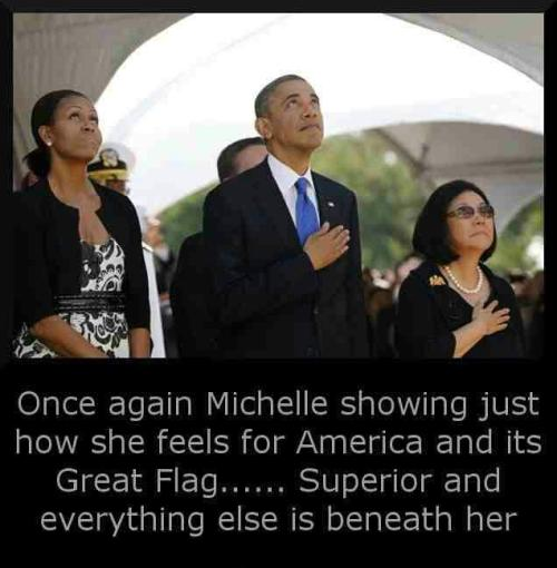 "Jeez, Michelle. Don't you realize that if you don't cover up one of your tits with your hand whenever a certain brightly-dyed piece of fabric is displayed you hate this entire country, what it means, and all that it stands for? Do you even understand the meaning of the phrase ""empty gesture""? How about ""groupthink""? I know you're a highly educated woman and way smarter than the minorities who voted against your husband, but I bet you can't even explain to me what it means to fetishize something. You have no idea what the true definition of idolatry is and you totally suck at conformity.Go back to Chicago. You are not American."