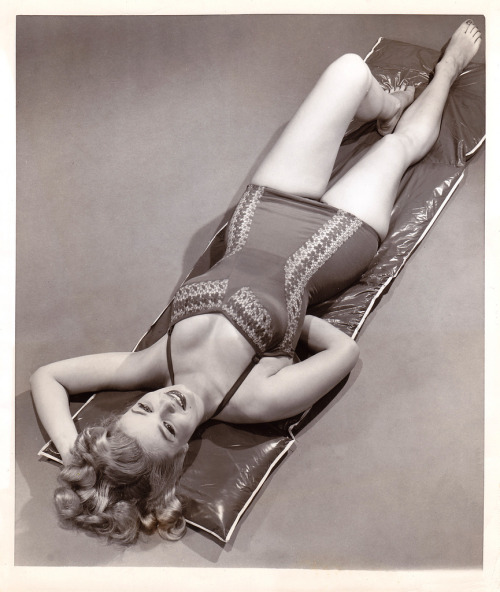 "Queenly form (by PopKulture)  Vintage photograph of Gloria Van Deweel, ""a relative newcomer to the Broadway stage, has combined her perfect form and swimming ability to win the title of ""1953 Legitimate Theatre Swim For Health Week Queen.""  Dated June 1953."