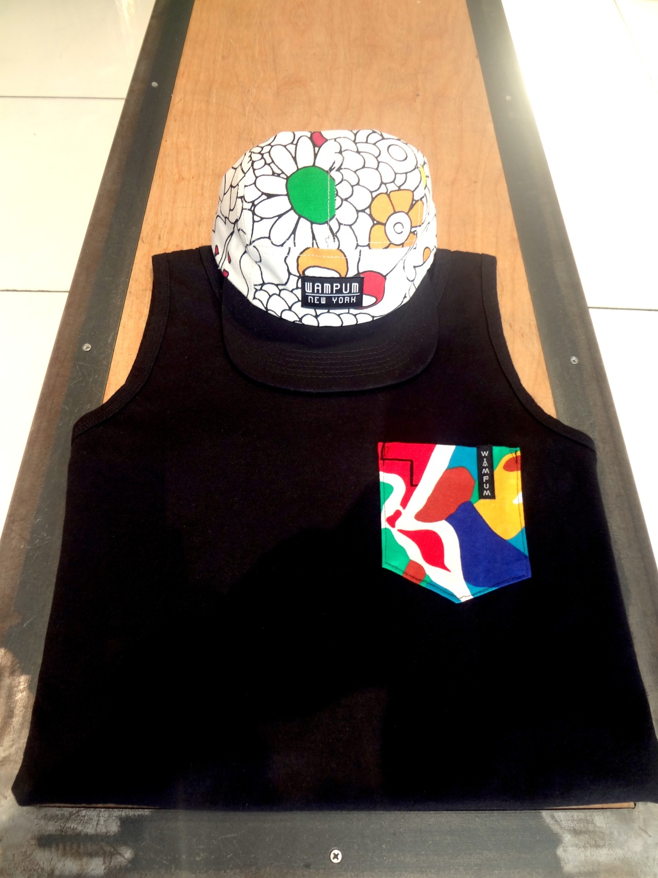 New Pocket Tank and Flower Five Panel available in all stores.