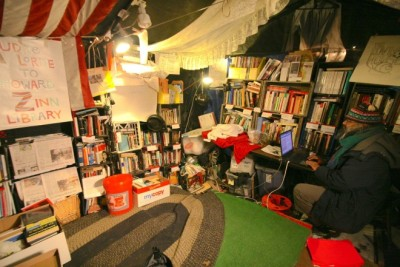 "The ""Audre Lorde to Howard Zinn"" Library, at Occupy Boston on December 1, 2011. Nine days later the camp was evicted. ""They were true libraries, trusting and trusted places. They were well-lit and quiet, kept as warm as possible through the fall and into winter. You could feel in the air how much the people loved the libraries. In Toronto, when the eviction came, they chained themselves around the library. In DC during the eviction, the librarians accepted being locked in for hours without food or water or bathrooms just to protect their library"" - Quinn Norton, ""A Eulogy for #Occupy"""
