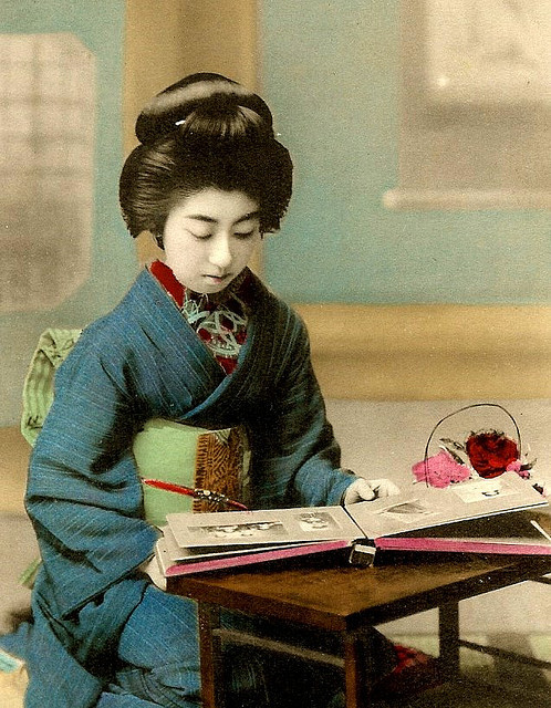 "GEISHA LOOKING AT PHOTOGRAPHS (16) — Posthumously Awarded Full Membership in Flickr (TERUHA, the ""NINE-FINGERED GEISHA"") by Okinawa Soba on Flickr.Via Flickr: (Sorry for the ""ALL CAPS"" portion below. Keyboard/Computer problem would not allow lower-case at the time I wrote this. And now…I don't feel like re-typing it all !) GEISHA NAMED TERUHA. BORN IN 1896, SHE WAS A ""PROPERLY DEFLOWERED"" GEISHA FROM THE AGE OF 13, AND WENT ON TO GREAT FAME, INFAMY, AND EVENTUAL RETIREMENT AS A BUDDHIST MONK — THE CHIEF PRIESTESS OF A  TEMPLE IN KYOTO..  WHEN SHAVING OFF HER LUXURIOUS HAIR TO COMPLETE BALDNESS AS HER FAITH REQUIRED, SHE THOUGHT TO KEEP IT AS A SYMBOL AND REMINDER OF THE VANITY CONNECTED WITH THE OFTEN WILD LIFE SHE HAD LED WITH HER MANY AFFAIRS, AND SEVERAL LONELY, BROKEN MARRIAGES. SHE KEPT HER HAIR IN A BOX UNTIL SHE DIED, AND HAD IT BURIED ALONG WITH HER ASHES. DURING HER LIFE, SHE AUTHORED SEVERAL BOOKS. IN HER YOUTHFUL DAYS - WHEN THE ABOVE PHOTOGRAPH WAS TAKEN — SHE WAS NICK-NAMED THE ""NINE-FINGERED GEISHA"" FOR ATTEMPTING TO CUT OFF HER LITTLE FINGER WHEN, AS A YOUNG TEENAGER, SHE WAS SMITTEN IN A PASSIONATE LOVE AFFAIR WITH ONE OF HER PATRONS.  SHE DIED IN 1996, JUST BEFORE HER 100TH BIRTHDAY.   The above comments barely scratch the surface. For a little deeper scratch, here's a great one page story with photos that show her over the years until near her death : [NOTE:  AFTER ALMOST A DECADE ON LINE, THIS LINK TO JIM GATLIN'S TRIBUTE TO TERUHA SITE WENT DEAD IN 2009. JIM HAD PASSED AWAY MANY YEARS AGO, AND APPARENTLY HIS FAMILY HAD BEEN KEEPING IT UP AND RUNNING. BUT, NO LONGER. I AM KEEPING THE LINK HERE AS AN EMPTY BOOKMARK. WHO KNOWS, SOMEONE MIGHT RESURRECT IT AGAIN, OR OKINAWA_SOBA WILL HAVE TO BUILD A NEW TERUHA SITE FROM SCRATCH]. www.geikogallery.bizland.com/Teruha1.htm In the meantime, here is a partial restoration of the content : www.immortalgeisha.com/bio_past.php?id=14 Okinawa_Soba has about 50 pages of detailed history on her, including comments from Japanese who knew her over the years…..revealing the seldom-mentioned fact that she had a daughter.  I still get quite when I think about the time I was in Kyoto, only 10 minutes away from where she was alive and well, a few short years before her death. I had a good collection of her postcards, and figured she must have been someone special or important — but had falsely assumed she had passed away.  If I had only known she was right down the road, I could have visited her, and seen her own postcard collection of herself (!) which she kept until she died. We could have talked, and I could have asked her a million questions about all of these old photos, and her life. She would have been happy to have entertained me. She was that kind of kind woman, who had no qualms about reminiscing.  BUT….I did not even know she was there until she had passed away. Finding out that I had been so close, was, for a long moment, an almost unbearable burden. Another Geisha who also became a nun has a more tragic story, and lost much more than her finger at the hands of an insane man : flickr.com/photos/ionushi/1568521865/   (Why is it always men who do these things?)   [From a OKINAWA SOBA flickr set of 19 Meiji-era Photographs (and a few from the Taisho era) depicting real Geisha Girls looking at old Photograph albums, images, and stereoviews. Posted in response to flickr member SignFire who said we should sign these girls up for a flickr account. Apparently, these girls don't have computers where they are, so we'll have to make do with posthumously awarding these PHOTO-LOVING GEISHA with an honorary membership in flickr.]  Photographer Unknown."