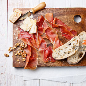 A stunning cheese board combination with prosciutto, black olives & walnuts. (via by Natalia Lisovskaya)