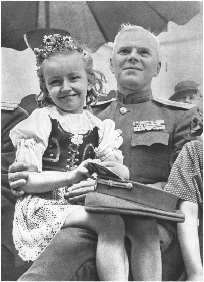 ppsh-41:  Czech girl sitting on the lap of a Lieutenant general of the Red Army.