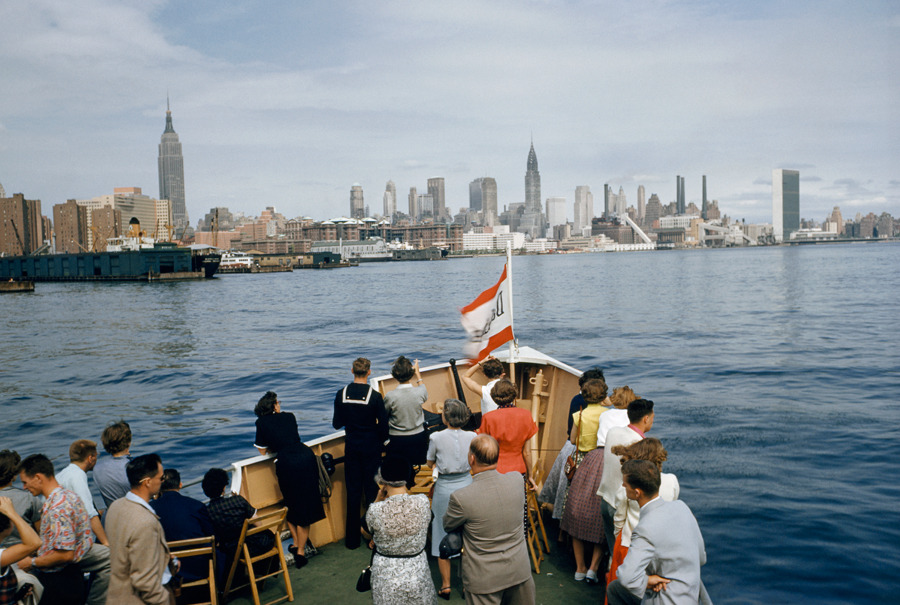 natgeofound:  Tourists look at Manhattan from a sightseeing boat on the East River, December 1954.Photograph by Robert Sisson, National Geographic