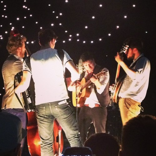 "mumfordandsonsblog:  Mumford & Sons perform Bruce Springsteen's ""I'm On Fire"" from the back of the audience at Calgary's Scotiabank Saddledome on 21st May, 2013. Photo courtesy of @chant_b on Instagram."