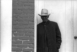 Man in a doorway, 1962, Chicago, Illinois. Photograph by Declan Haun.  Want a copy of this photo?  > Visit our Rights and Reproductions Department and give them this number: iCHi-36885 Connect with the Museum