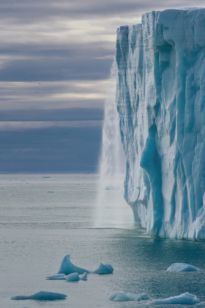 evocates:   Glacial Waterfall by Mike Reyfman