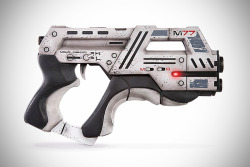 Mass Effect M-77 Paladin Pistol Replica  limited to 200 pieces worldwide and cost $400, this fine replica is hand-finished and hand-painted by the folks at TriForce and marketed by none other than ME3 developer, BioWare. and so, yes. it is the official replica.