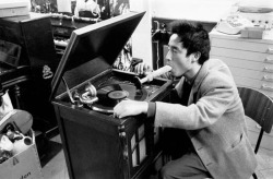 vinylespassion:  Nam June Paik demonstrates Listening to Music through the Mouth in Exposition of Music Electronic Television, 1963. Photo by Manfred Montwé.