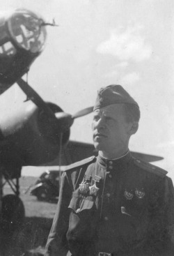 ppsh-41:  Major Pavel Mironovich Nikiforov with an Ilyushin Il-4 bomber at an airfield in 1944.