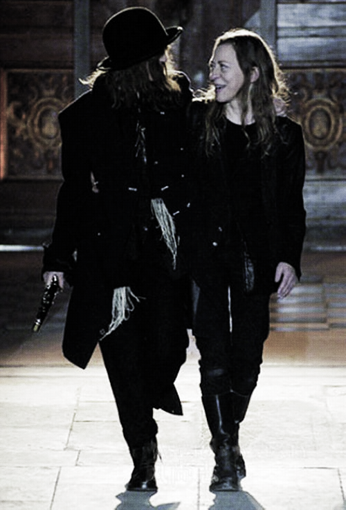 "Ann Demeulemeester and Patti Smith at the conclusion of Ann's Fall 2006 collection Patti Smith's style has become almost as legendary as her music and it's been emulated countless times. If it weren't for Patti Smith, Hedi Slimane for Dior wouldn't have been a huge commercial success; and Ann Demeulemeester probably wouldn't have designed at all.In fact, Demeulemeester claims Smith not only as her muse, but also as her soul mate. Smith has had countless creative partnerships over the course of her artistic career, but none quite like her long-term friendship with the Belgian fashion designer.Both Smith and Demeulemeester have stressed that their friendship is more than joint ventures. There seems to be a fierce sense of understanding between them that of a kind shared only by kindred spirits. ""Patti has always been part of my universe,"" Demeulemeester has said, ""but I don't want to vulgarise our contact, which is really magical and beautiful. It's almost sacred to me, which is why I never talk about it in the press. Please don't reduce our friendship to a trouser or a skirt."""