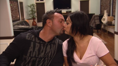 "Is JWOWW Planning a Vegas Wedding?! Fiance Roger Mathews Says… — Exclusive We were thrilled when we heard Snooki and JWOWW got renewed for a third season, but will the MTV cameras be there to capture JWOWW and her fiance Roger Mathew's walk down the aisle? Wetpaint Entertainment caught up with Jenni's ""gorilla juicehead"" at the GBK Gifting Lounge during the MTV Movie Awards weekend to talk about the couple's future plans — from weddings to babies, and more! Wetpaint Entertainment: So do you and Jenni have any wedding plans set yet? Roger Mathews: We don't have a definite date yet. [Hurricane] Sandy definitely set us back. My house got destroyed. The house Jenni and I share together was virtually untouched except for some wind damage, but the house that I owned prior had over three feet of water in it. So that was a huge setback. And just the Shore not looking the same, you know. To get married back there at almost any location is tough right now. The last time we spoke to Jenni about it she said she specifically wanted a 'Vegas Sh*tshow' wedding. Has that changed? Roger Mathews: We had tossed around every idea you can imagine, from destination weddings to doing it locally. There are pros and cons to both but the most important thing to both of us is that all of our friends and family be there and that's a little harder to do with a destination wedding. But we haven't ruled it out. We really haven't made plans. But a shore wedding is definitely a possibility. I don't know that it will be Seaside, but it could definitely happen in Jersey. Will the whole cast be there? Roger Mathews: Oh yeah. Pauly will probably be DJ'ing it. He made the offer. We're holding him to it! Is Lorenzo giving Aunt Jenni baby fever? Roger Mathews: I don't think so. Right now she's very focused on her career. We definitely talk about it, but we want to plan it. We're planners. It's something we both want to do and I'm not getting any younger – let's be honest – but no baby yet. I would like to do it sooner rather than later though. What do you think of the rumor Nicole lost her baby weight in an unhealthy way? Through pills and boozing? Roger Mathews: I think she looks amazing! From knowing her, I don't see that happening. She's a gym guru, she's dedicated. I really believe its through healthy living, working out and exercise. Kudos to her. More power to her."