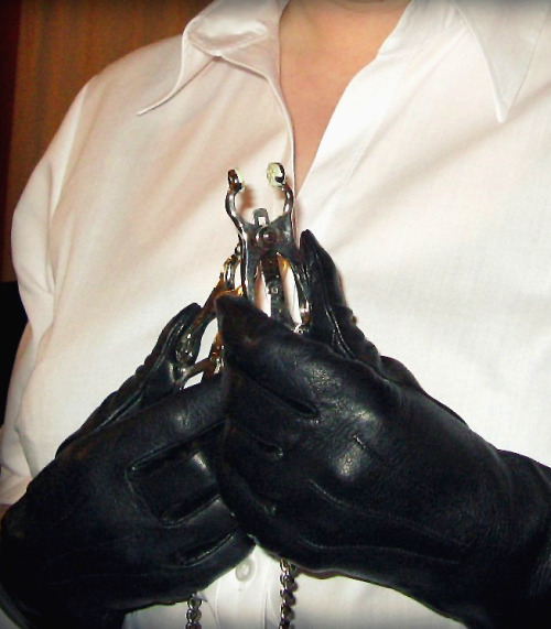 Crisp white shirt, leather gloves, nipple clips… I guess it's not a gentle tease and denial session.
