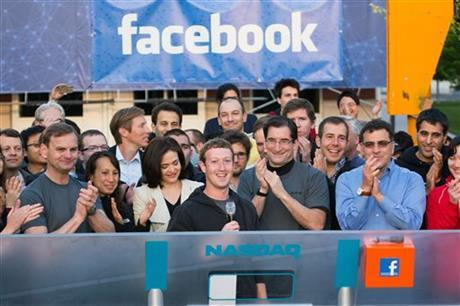 A year after IPO, Facebook aims to be ad colossus BARBARA ORTUTAY, ap.org NEW YORK (AP) — It was sup­posed to be our IPO, the peo­ple's pub­lic offer­ing.Face­book, the brain­child of a young CEO who saun­tered into Wall Street meet­ings in a hood­ie, was going to be big­ge …