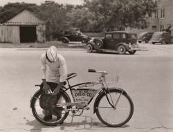 "A ""drugstore cowbow"" preparing to deliver orders on his bicycle in Texas, 1938.Photograph by Luis Marden, National Geographic"