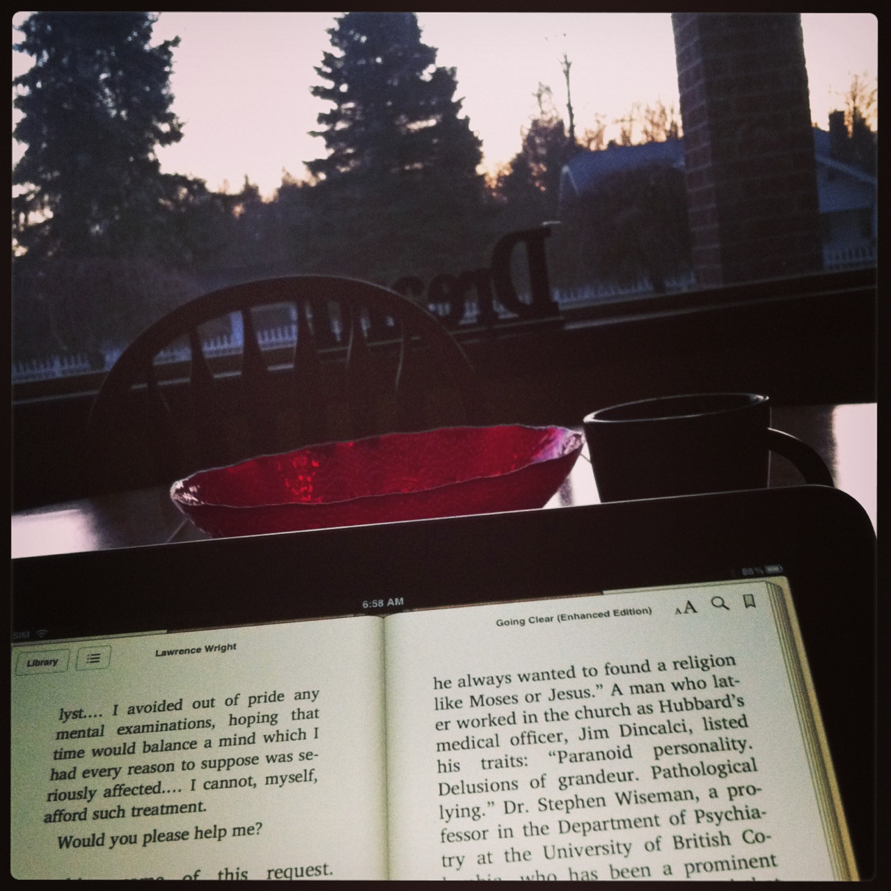 "Reading ""Going Clear"" with a cup of coffee and the sunrise. Pretty good morning so far."